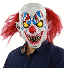Страшный клоун с желтыми глазами